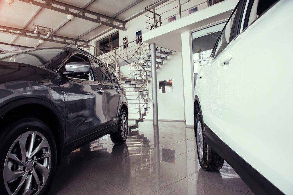 of the car in the spacious showroom with large windows